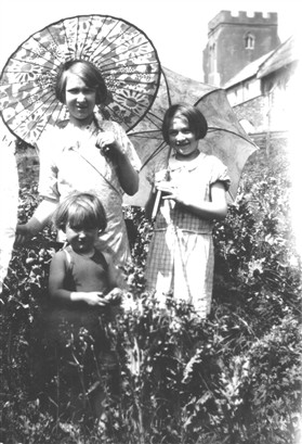Photo:The three little Freestone girls who lost their home in the  fire, seen here in the Town House garden