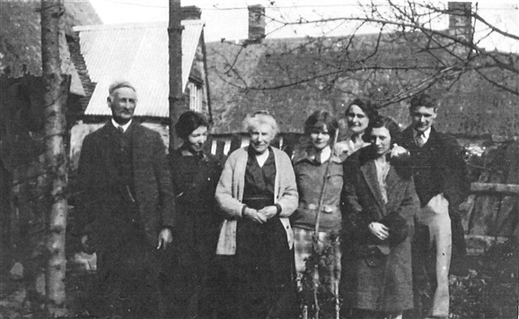 Photo:Terry Bullen's great-grandparents and other family members at 10.12 High Street in the 1930s