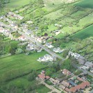 Photo:High Street, 13 May 2012. West Farm Barns in the foreground.