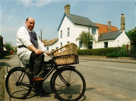 Photo:Michael on his bike delivering to the village