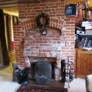 Photo:Front room fireplace. The further brick infill is apparent.