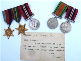Photo:The medals awarded to Len with the letter sent by him when he was a prisoner of war. The medals are on display in the village hall