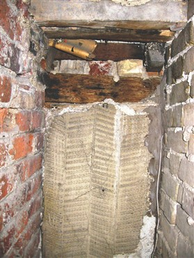 Photo:Original 'sparrow-peck' pargetting. Red brick chimney stack on the left, yellow brick front wall on the right.