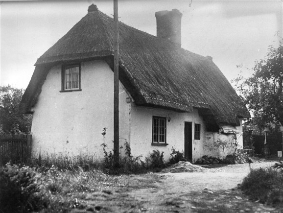 Photo:The cottage as Widow Adams might have known it. Note the bread oven on the side.