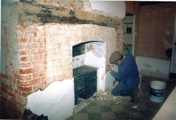 Photo:A small iron stove had been installed in an ingle nook fireplace. This was removed . . .