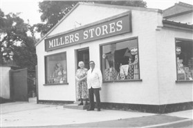 Photo:Mr & Mrs William Miller outside their extended shop in 1960