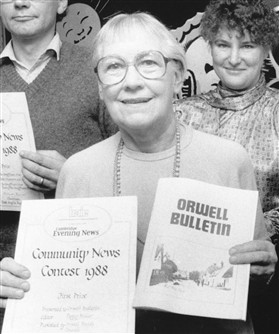 Photo:Editor Peggy Miller with prize certificate in 1988
