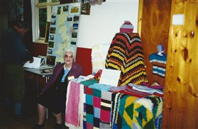 Photo:Mrs Watson with items knitted for charity by the ladies of Lordship Communal Club.
