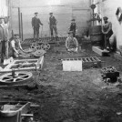 Photo:Foundry workers preparing sand castings in the Iron Works. Click on the photo to enlarge it.