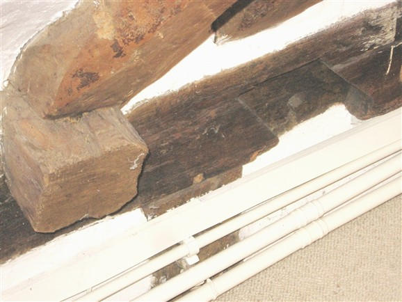 Photo:A main tie beam has been cut to allow better access upstairs. The joint on the right is a notched lap joint - a very early type of joint used in the 15th century. It may indicate that this property is older than first thought, or that the timber has been re-used.