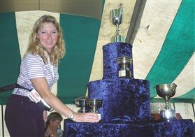 Photo:Joanne Korosi, Chairman, with some of the Society's trophies at the 2010 Show
