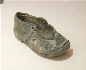 Photo:A tiny shoe found in the structure.